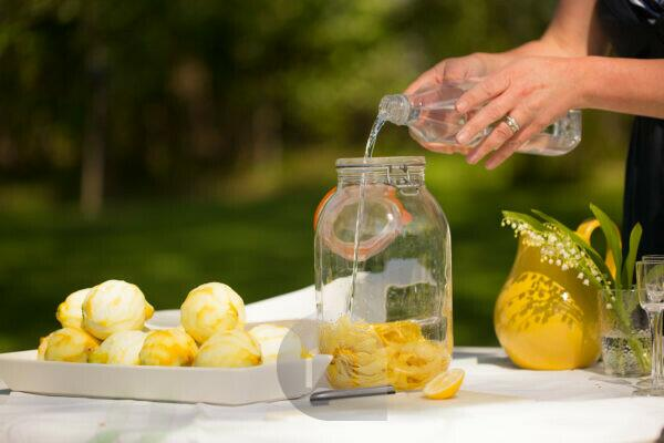 Making homemade Limoncello, summerday in garden