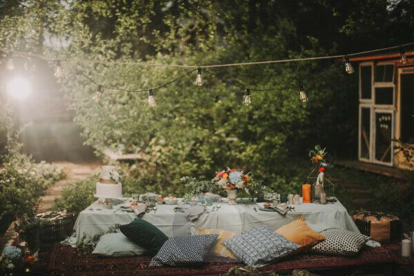 Festive laid table at alternative wedding celebration outside