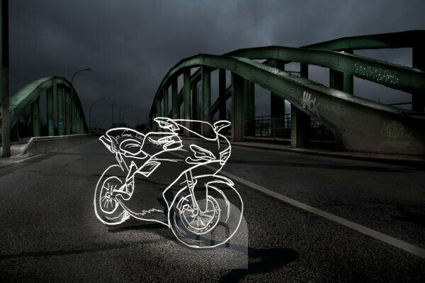 light drawing of a racing moto radian on a bridge at night,