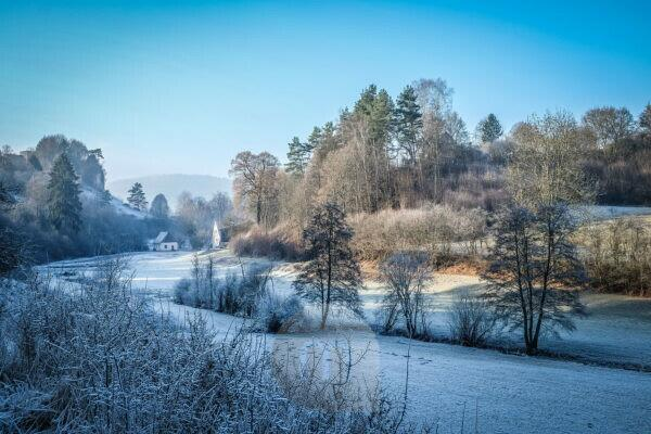 Sunny winter morning with hoarfrost close Thuisbrunn in Franconian Switzerland