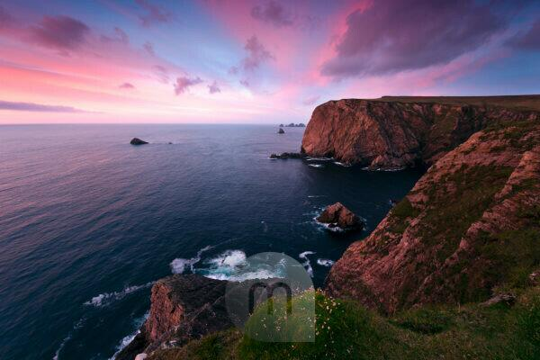 Colored sunset at Benwee Head, County Mayo, Ireland