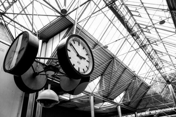 several clocks in the Munich main station, b/w