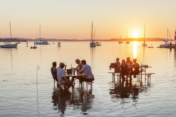 Tables in the water, sundowner bar in Übersee am Chiemsee, Chiemgau, Upper Bavaria, Bavaria, southern Germany, Germany, Europe
