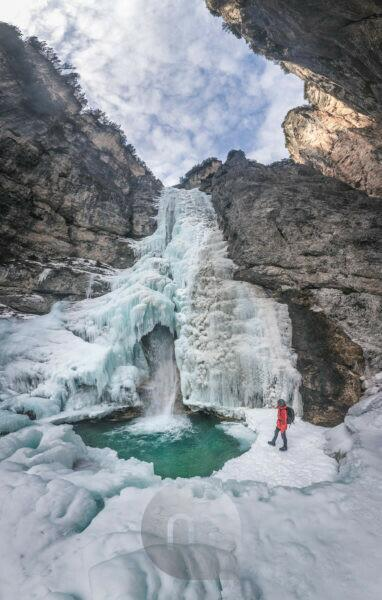 Winter tour at Fanes waterfalls, Dolomiti d Ampezzo natural park, Cortina d Ampezzo, Belluno, Veneto, Italy