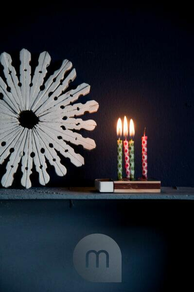 Winter decoration with burning candles on matchbox