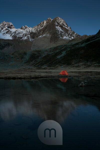 Camping at mountain lake in Kraspestal, Kühtai, Stubai Alps, Tyrol, Austria