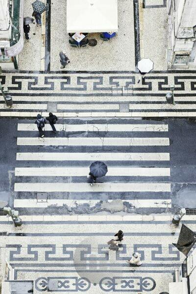 People with umbrellas, vertical view from the Elevador de Santa Justa, historical lift, Lisbon, Portugal,