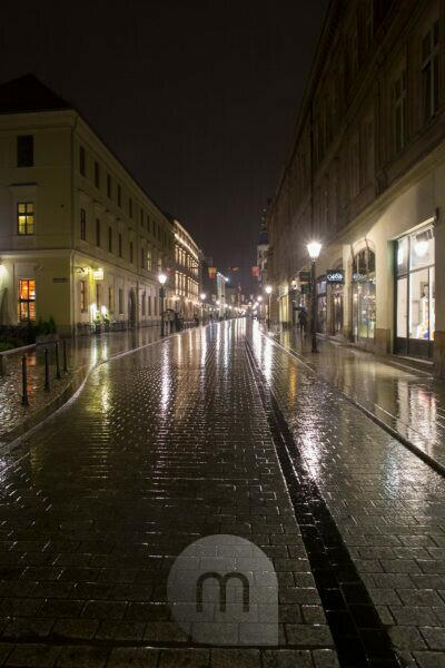 Street view in rainy evening, Old Town Krakow, Poland