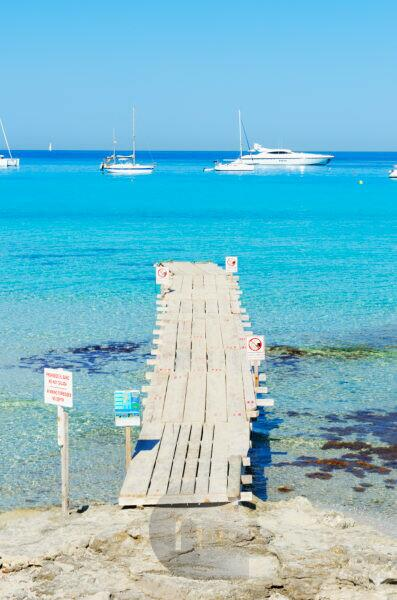 Pier in Formentera turquoise waters,  Formentera, Balearic Islands, Spain