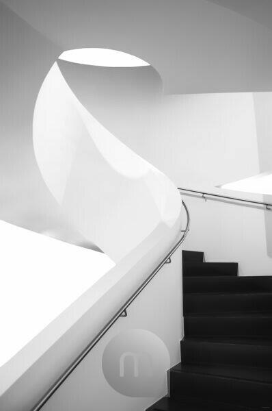 Spiral staircase in the Dornier Museum Friedrichhafen, light course, black and white, futuristic,