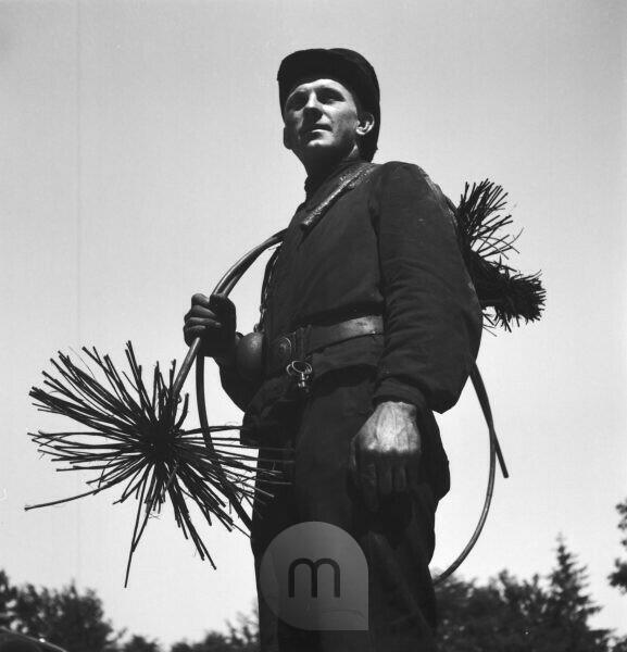 A chimney sweeper on his way to work. Germany 1930s.