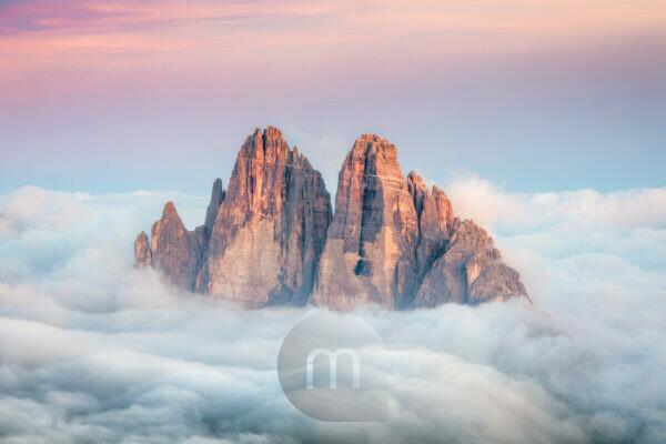 Tre Cime di Lavaredo emerging from the sea of clouds, Sexten Dolomites, South Tyrol, Bolzano, Italy, Europe