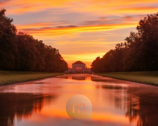 Germany, Bavaria, view from the middle channel to the Nymphenburg Palace at sunrise